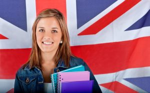 English female student with the British flag at the background